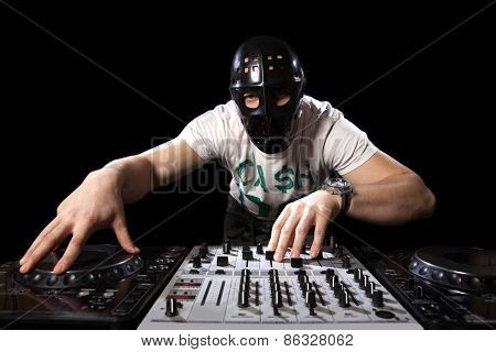 Disc Jockey With Mask Mixing Music
