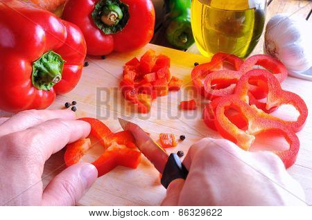 Chef Cutting A Red Pepper On A Cutting Board