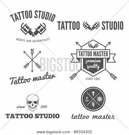 Set of logo, emblem, badge, print, sticker or logotype elements for tattoo salon or tattoo master