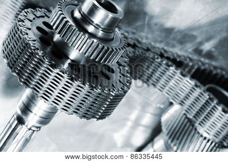 titanium and steel cogs powered by large timing-chain, aerospace engineering parts in blue