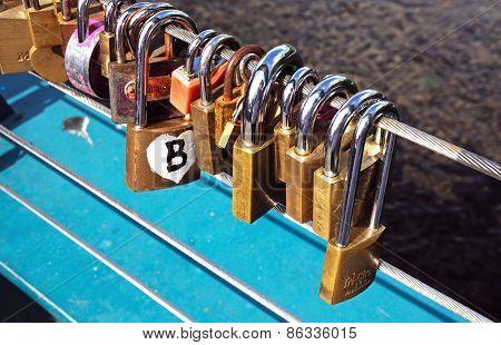Love locks attached to a bridge.