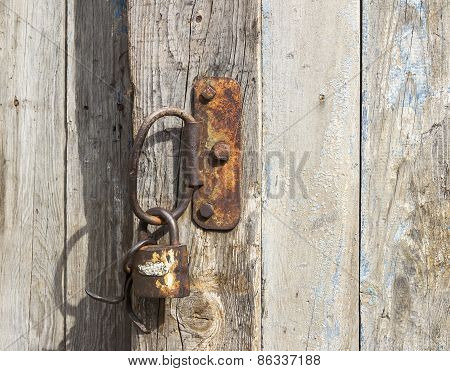 Old Padlock On The Wooden Door