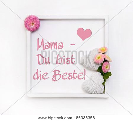 Greeting card for mother's day with white hearts and pink daisy flowers in shabby chic style and german text.