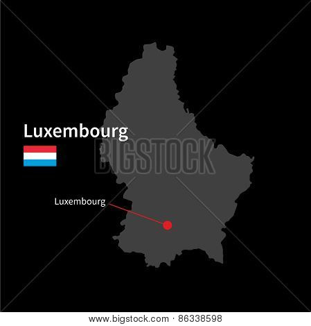 Detailed map of Luxembourg and capital city Luxembourg with flag on black background