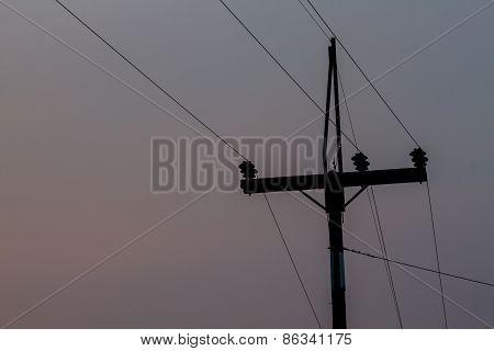 Electricity Pole On Dark Sky