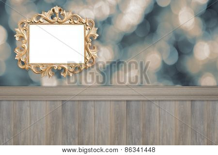 Advertising space with ornate gilt frame and wooden panel wall