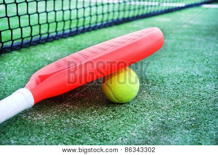 Paddle tennis racket and ball