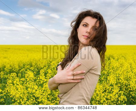 girl portrait in yellow flower field