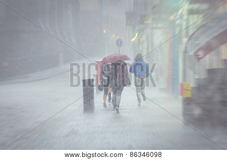 Group of girls walking at summer rain in the city