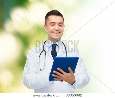 healthcare, profession, people and medicine concept - smiling male doctor in white coat with tablet pc computer over green background