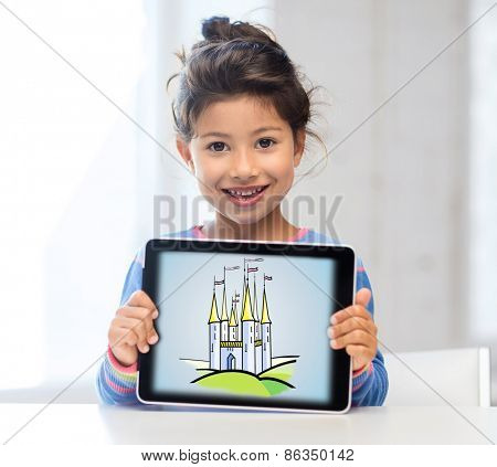technology, childhood, entertainment, fairytale and imagination concept - happy little girl showing picture of castle on tablet pc computer screen at home