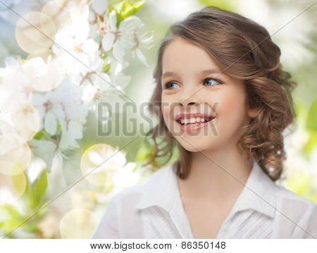 people, children, season and happiness concept- happy girl over summer or spring garden background