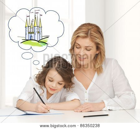 people, family, education, childhood and leisure concept - happy mother and daughter drawing or doing home work and thinking about fairytale castle