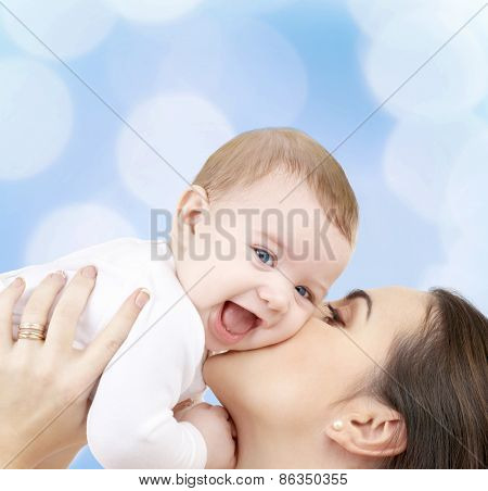 family, child and happiness concept - happy mother with baby