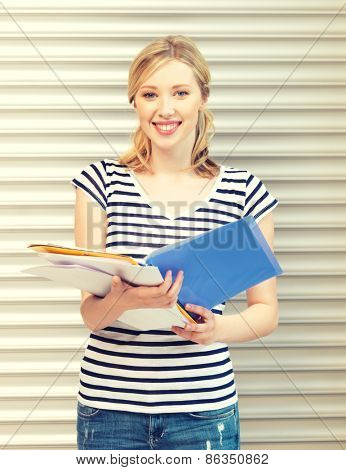 picture of happy teenage girl with books and folders