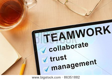 Tablet with words teamwork.