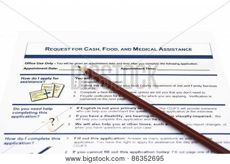 Request For Cash Food And Medical Assistant Application Form And A Pencil With Clipping Path