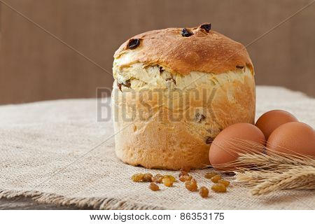 Tasty Backed Traditional Russian Kulich Easter Cake With Raisins And Eggs On Vintage Textile
