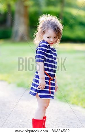 Portrait Of Adorable Little Kid Girl In Summer Park