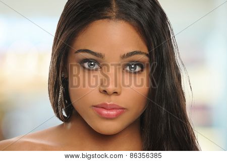 Portrait of beautiful young black woman with background out of focus
