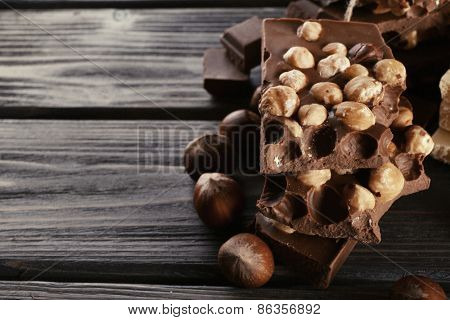 Set of chocolate with hazelnut on wooden background