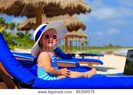cute little girl in big hat on summer beach