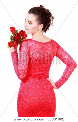 Beautiful Young Woman In A Red Evening Dress