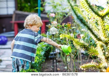 Little Toddler Boy Having Fun With Splashing Water In Summer Garden.