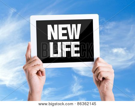 Tablet pc with text New Life with sky background