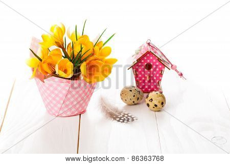 Crocus Flowers On White Wooden Background, Spring Decoration With Quail Eggs And Birdhouse