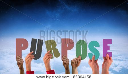 Hands holding up purpose against white clouds under blue sky