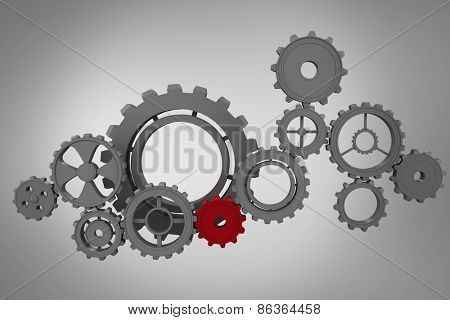 Cogs and wheels against grey vignette