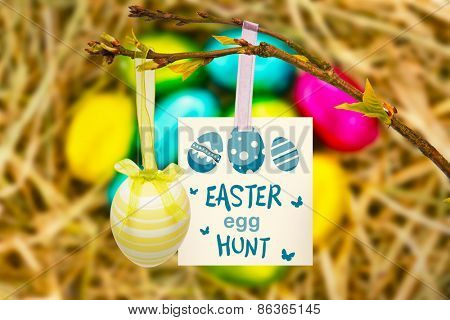 easter egg hunt graphic against easter eggs grouped together on straw