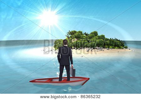 Businessman in boat against tropical island in blue ocean