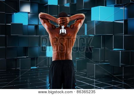 Rear view of a fit shirtless man lifting dumbbell against blue and black tile design