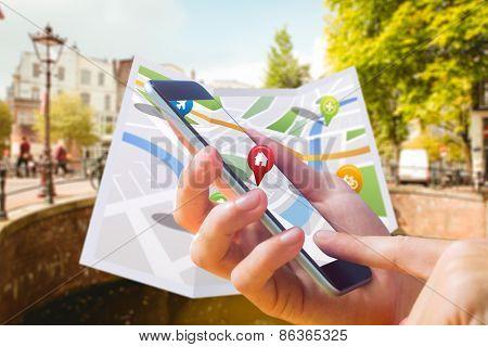 Man using map app on phone against bridge in amsterdam