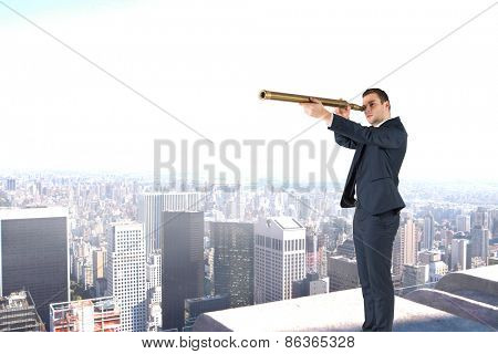 Businessman looking through telescope against high angle view of city