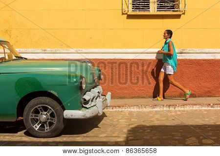 Trinidad - February 24: Streets Of Trinidad With Classic Old Car And Woman Walking On February 24, 2
