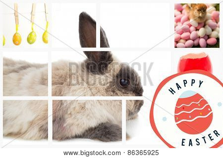 happy easter graphic against four easter eggs hanging from a line