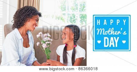 mothers day greeting against pretty mother sitting on the couch with her daughter offering flowers