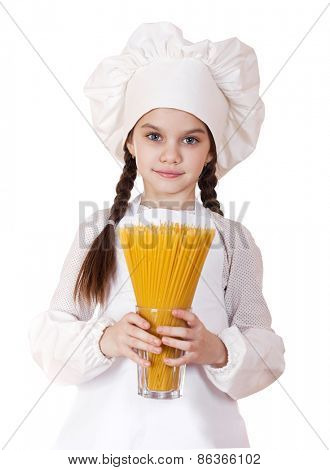 Portrait of a little girl in a white apron holding a glass of spaghetti, isolated on white background