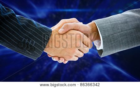 Business people shaking hands against blue abstract design
