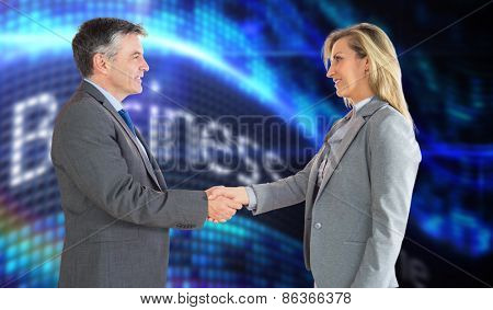 Pleased businessman shaking the hand of content businesswoman against business online on digital screen