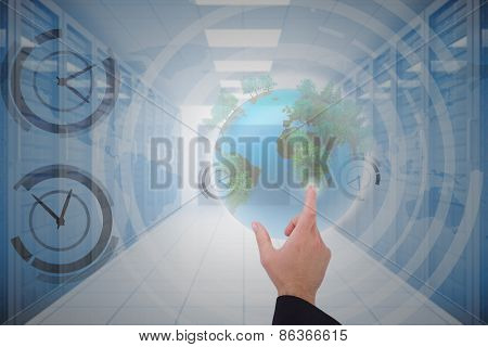 Businessmans hand presenting against server hallway