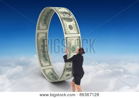 Angry businesswoman gesturing against blue sky over clouds