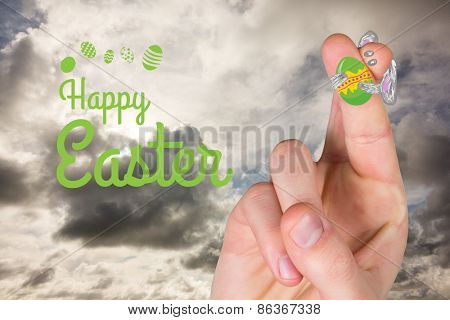 Fingers as easter bunny against blue sky with white clouds