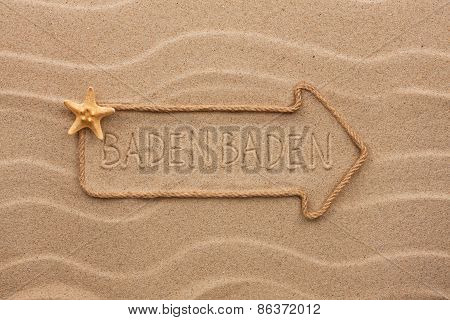 Arrow Made Of Rope And Starfish With The Word Baden Baden On The Sand