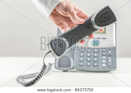 Businessman Holding A Telephone Handset