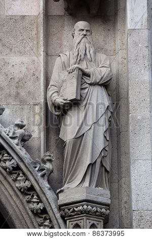 VIENNA, AUSTRIA - OCTOBER 10: Statue of Saint, Votivkirche (The Votive Church). It is a neo-Gothic church located on the Ringstrabe in Vienna, Austria on October 10, 2014