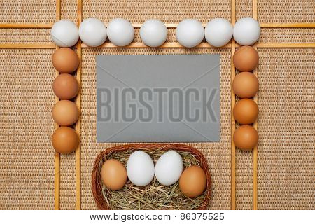 Gray Paper And Eggs On Background